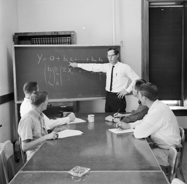 Students in an economics class in 1963