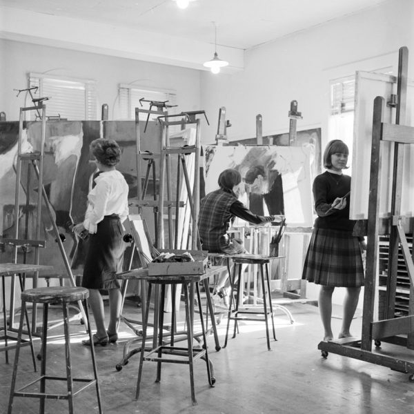 Students engaged in a painting class in 1965