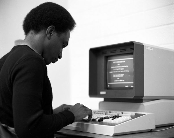 A student using early word processing to do schoolwork in 1983