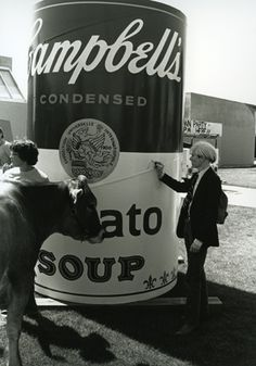 Andy Warhol signs Soup Can