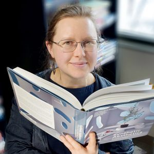 Erika Szymanski behind book