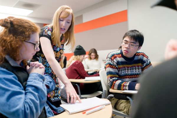Allison C. White, assistant professor of political science, helping students in class