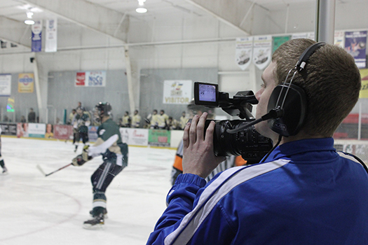 Student films a hockey match for news broadcast