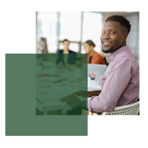Young professional man smiling during collaborative team meeting
