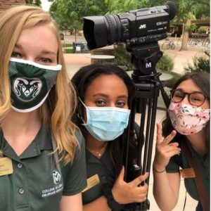 The CLA Coordinators wearing masks while filming on campus