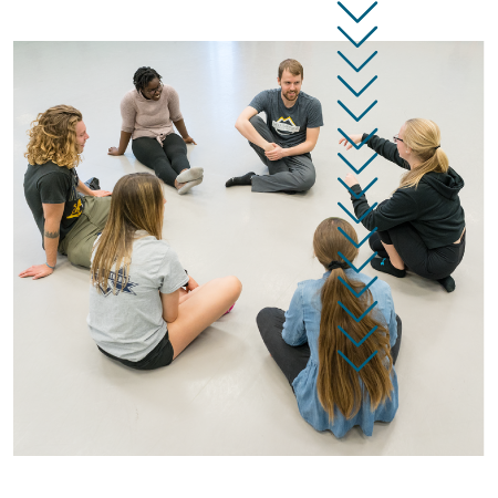 Students gather in a circle during a dance class
