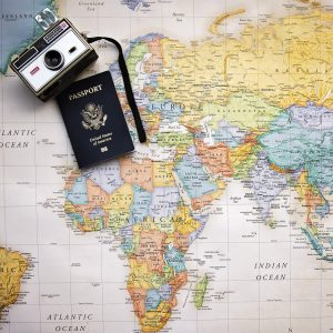 Map of the world with a camera and passport