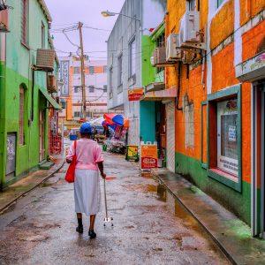 Woman walking in a Caribbean Street