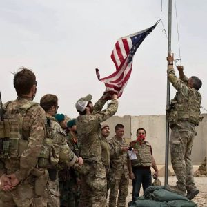 American Troops taking down the U.S. flag from a base in Afghanistan