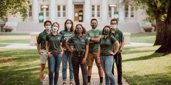College of Liberal Arts students wearing masks together on the Oval